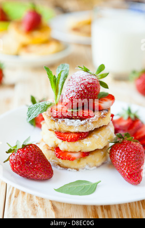 curd pancake with strawberries and milk, food close up - Stock Photo