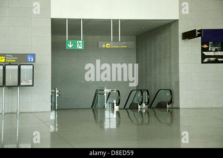 Exit to baggage claim on Airport Malaga with escalators. Costa del Sol, Spain. - Stock Photo