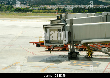 Boarding bridges to embark at airport of Malaga, Costa del Sol, Spain. - Stock Photo