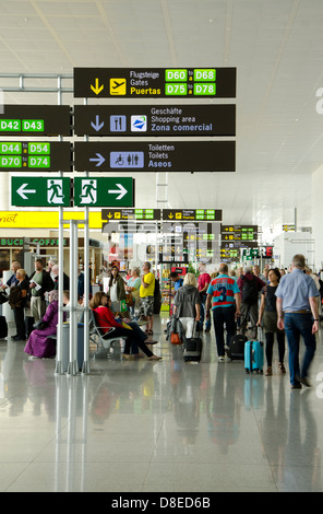 Departure of tourists at busy airport going to gates. Malaga, Costa del Sol, Spain. - Stock Photo