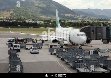 Luggage loaded in an Aircraft at the gate on Malaga airport, Andalusia, Spain. - Stock Photo