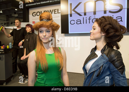 Poznan, Poland, hair models from different manufacturers advertise for hairspray - Stock Photo