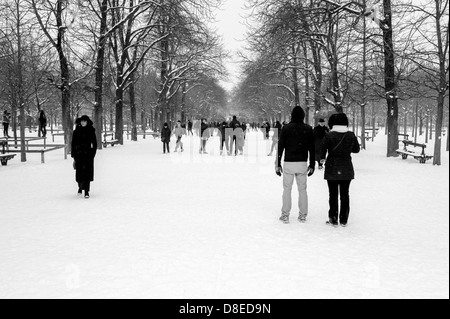 People enjoying snowy park. - Stock Photo