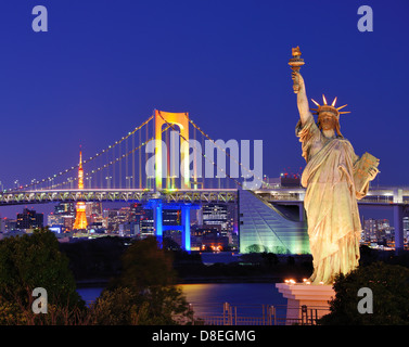 Statue of Liberty, Rainbow Bridge, and Tokyo Tower as seen from Odaiba in Tokyo, Japan.
