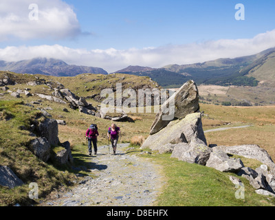 Hikers hiking on path from Rhyd Ddu up to Mount Snowdon in mountains of Snowdonia National Park (Eryri). Rhyd Ddu - Stock Photo