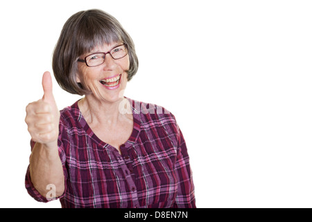 Happy smiling woman in glasses, pensioner showing thumbs up - Stock Photo
