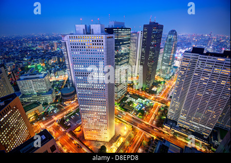 Financial buildings in the Shinjuku district of Tokyo, Japan. - Stock Photo