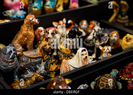 Display of dog figurines at the market in French Quarter, New Orleans, Louisiana. - Stock Photo