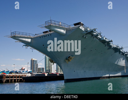 The USS Midway bow on, taken from the water. - Stock Photo