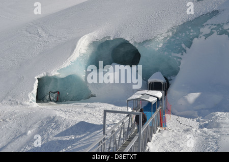 Entrance to ice cave under Mer de Glace glacier in Chamonix, french Alps - Stock Photo