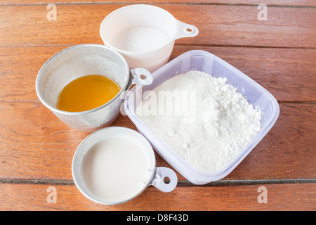 Set of baking ingredients flour, butter, sugar and milk - Stock Photo