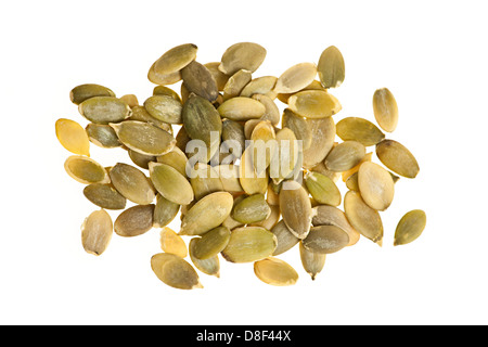Heap of raw pumpkin seeds isolated on white background - Stock Photo