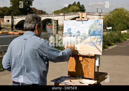 Artist painting on the Thames path near Richmond Bridge London England Europe - Stock Photo