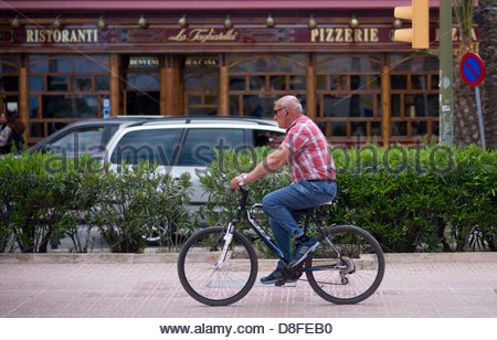 person riding bicycle - Stock Photo
