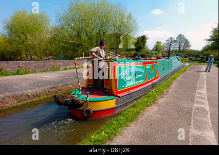 Narrow boat crossing the river Trent on an aqueduct on the Staffordshire and Worcestershire canal near Great Haywood - Stock Photo