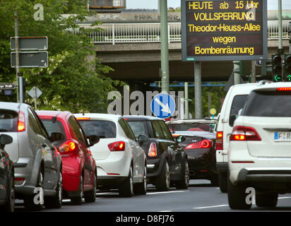 Cars sit on Gutleutstrasse while a sign reads the Theodor-Heuss-Allee is closed due to the diffusal of an unexploded - Stock Photo
