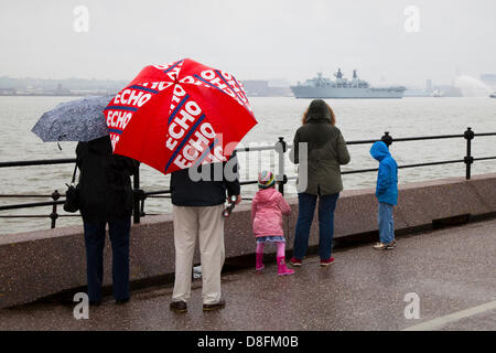 Liverpool, UK 28th May, 2013.   Spectators with Liverpool Echo promotional red umbrella at New Brighton watching - Stock Photo