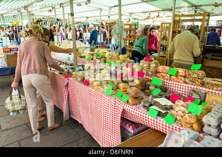 People at a market stall at Wells Farmers Market, Somerset, England, UK - Stock Photo