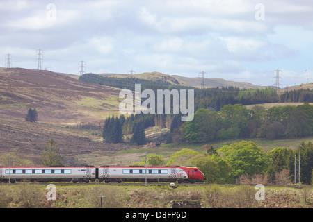 Class 390 Pendolino Virgin train at at Shap Wells, Cumbria, England, UK - Stock Photo
