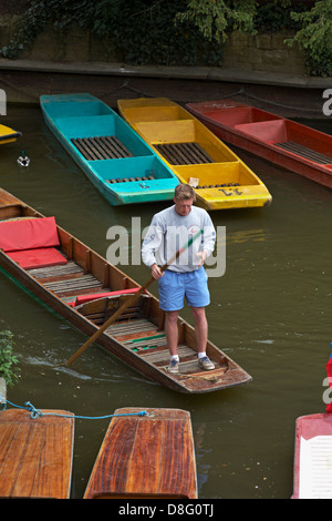 Coloured punts on the river Cherwell at Magdalen bridge at Oxford in May - Stock Photo
