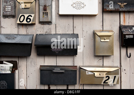Many mailboxes on a wall. - Stock Photo