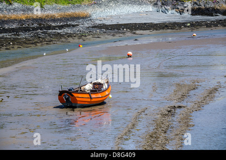 single boat on the shore during low tide - Stock Photo
