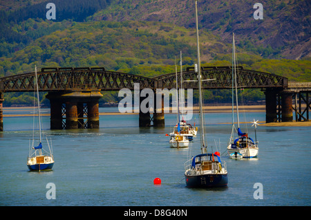 5 boats with Barmouth Bridge at the background - Stock Photo