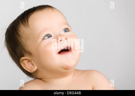 The blue-eyed baby, close-up. - Stock Photo