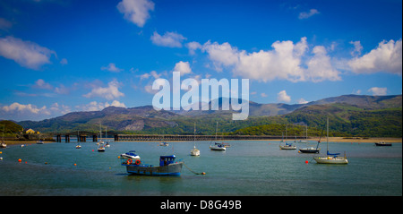 boats with Barmouth Bridge at the background - Stock Photo