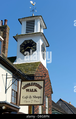 The clock tower of the Old Market Hall, High Street, Steyning, West Sussex, UK - Stock Photo