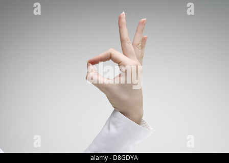 Woman's hand showing Ok symbol - Stock Photo