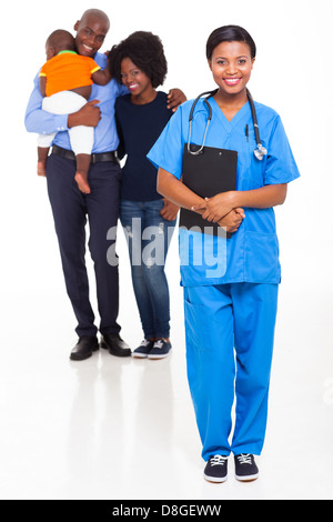 beautiful young black nurse with African family - Stock Photo