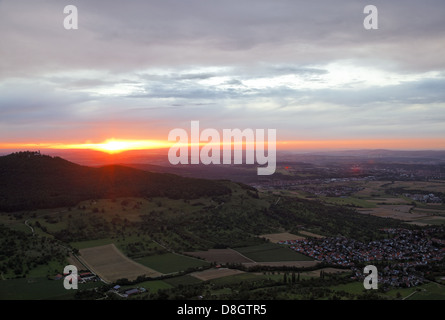 Germany, Baden-Württemberg, Swabian Alb plateau; View from Breitenstein, look at the Teck castle, sunset - Stock Photo