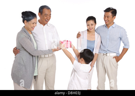 Boy giving grandparents gifts - Stock Photo