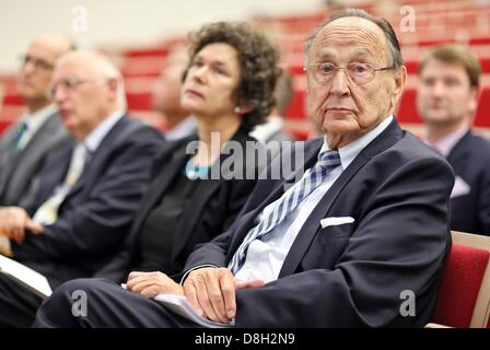 Former German Foreign Minister Hans-Dietrich Genscher (R-L), the rector of the University of Leipzig, Beate Schuecking - Stock Photo