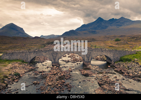Old Bridge over the River Sligachan in front of the Black Cuilin Hills, Isle of Skye, Scotland - Stock Photo