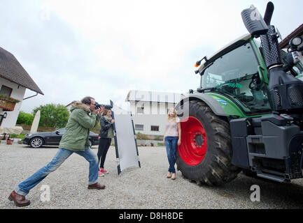 Model Theresa pose for photographer Steven Haider during the press photo shoot for the Bavarian Young Farmers Calendar - Stock Photo