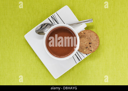 Hot Chocolate drink in white cup ,saucer and biscuit from above - Stock Photo