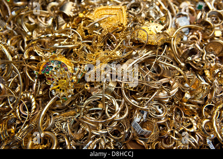 Recycling scrap gold to make a molten gold bar at the London Assay Office in Gutter Lane Photo Credit: David Levenson - Stock Photo