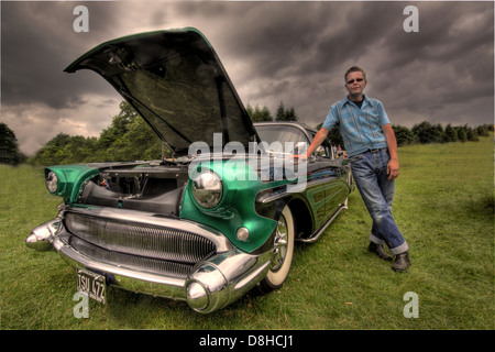 Black & Green 1957 Buick classic car ; Dave Weatherby with his award winning American 1957 classic car - Stock Photo