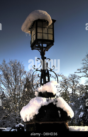 Snow on a churchgate lamp. Winter snowfall in Grappenhall Village, Warrington Cheshire, England, UK - Stock Photo
