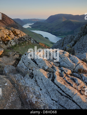 View from Haystacks at dawn over Buttermere and Crummock Water, High Snockrigg, Whiteless Pike and Grasmoor - Stock Photo