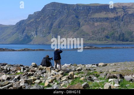 Ornithologists waiting and watching for white tailed sea eagles in carsaig bay. - Stock Photo