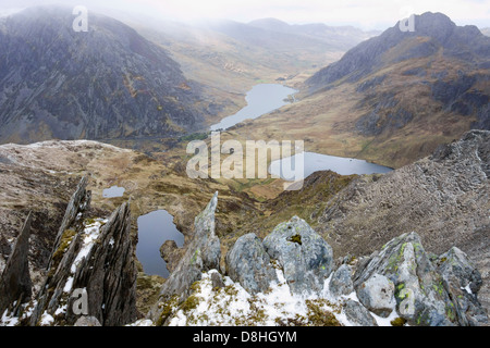 High view above Ogwen valley with Llyn Ogwen Llyn Idwal and Llyn Clyd from rocky summit of Y Garn mountain in Snowdonia - Stock Photo