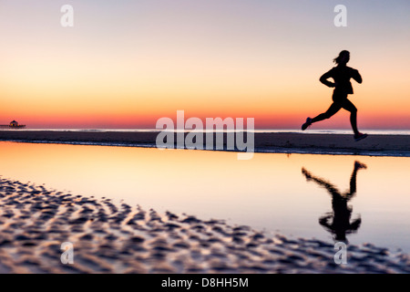 Female jogger at beach - Stock Photo