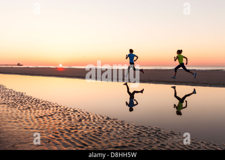 Female joggers at beach - Stock Photo