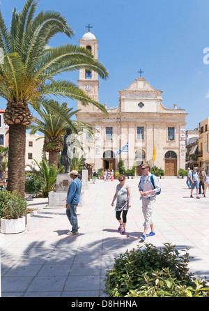 People walking across the square in front of Chania cathedral, Crete, Greece. - Stock Photo