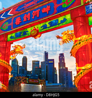 City Financial Skyline, River Hongbao decorations for Chinese New Year celebrations at Marina Bay, Singapore, South - Stock Photo