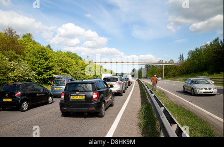 People on the road during a traffic jam due to an accident on the A20 dual carriageway road, Kent UK - Stock Photo