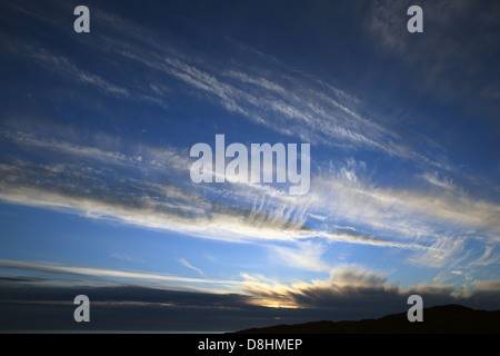 Cirrostratus high altitude clouds at evening sunset - Stock Photo